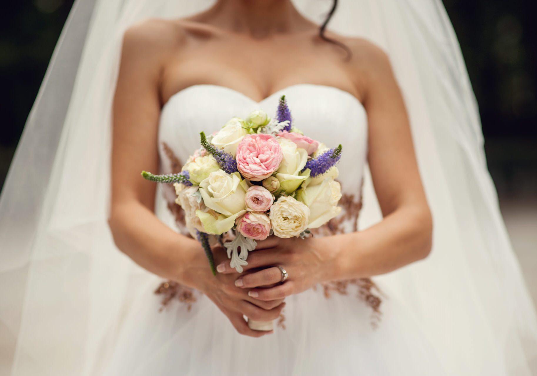 Bride hands with wedding bouquet